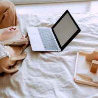crop-woman-using-laptop-on-bed-3975641